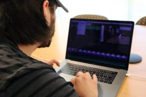 Two Summers student editing a video file