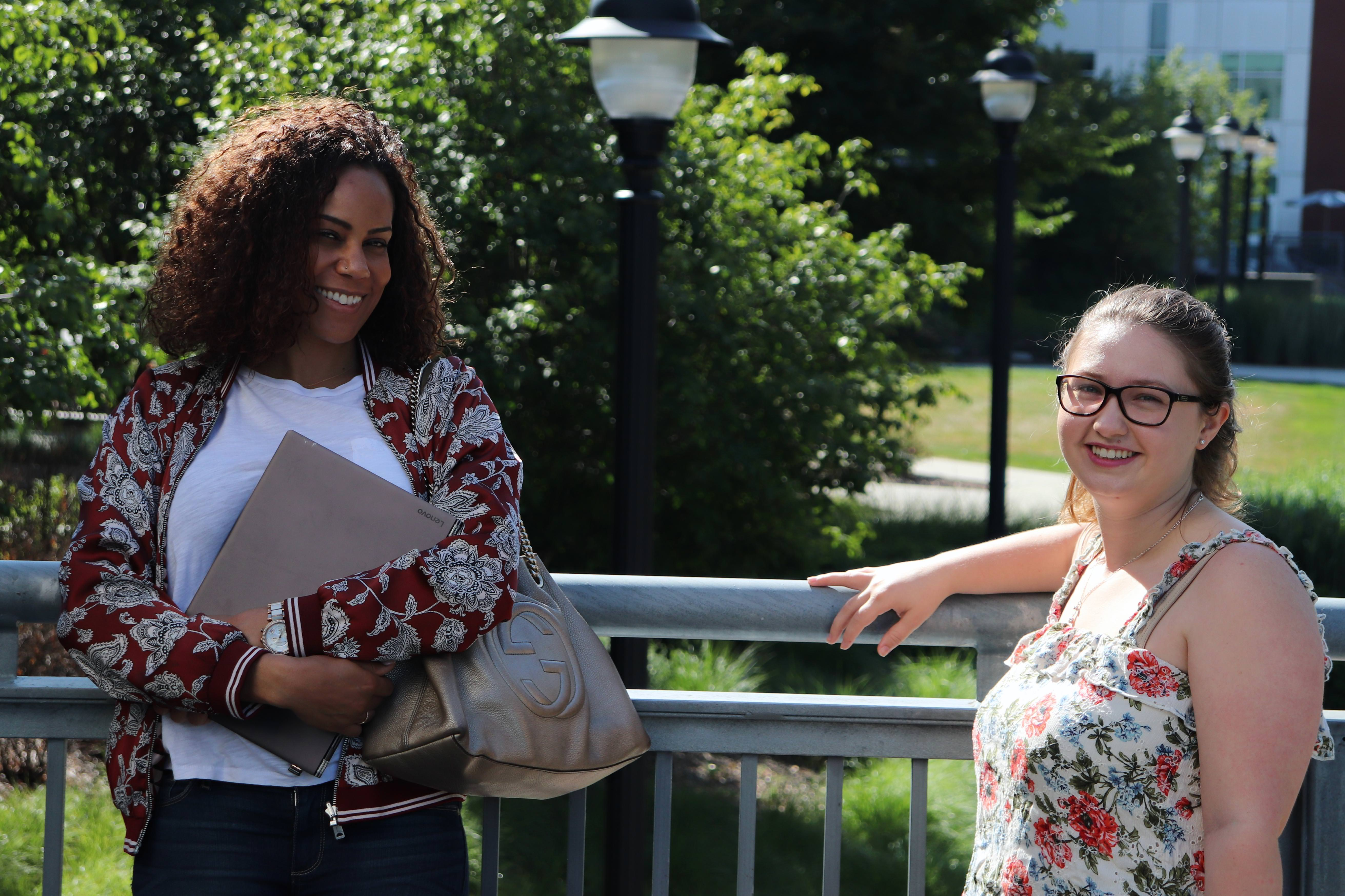 Two Summers students stand outside the Gentry building