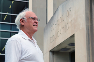 Dr. Michael F. Young stands outside the Gentry building