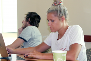 Two Summers students working at office table