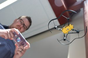 UConn Educational Technology graduate student flies a drone using a smartphone application
