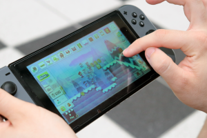 Student uses Nintendo Switch gaming device to practice computational skills